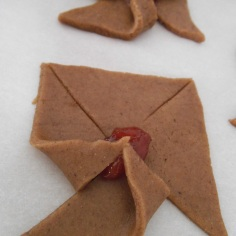 Fill with jam and fold alternating points inward.