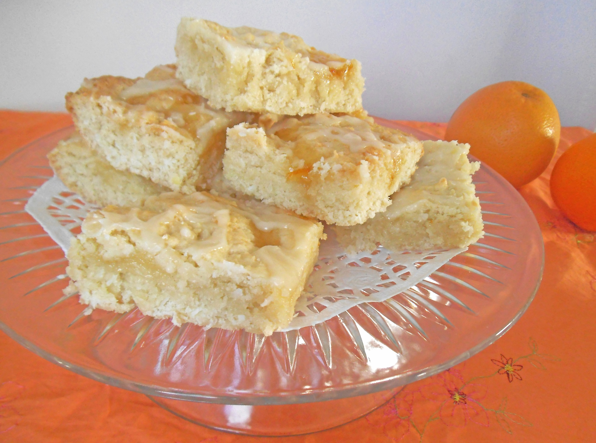 Marmalade-swirled lemon cookie squares on a glass serving platter