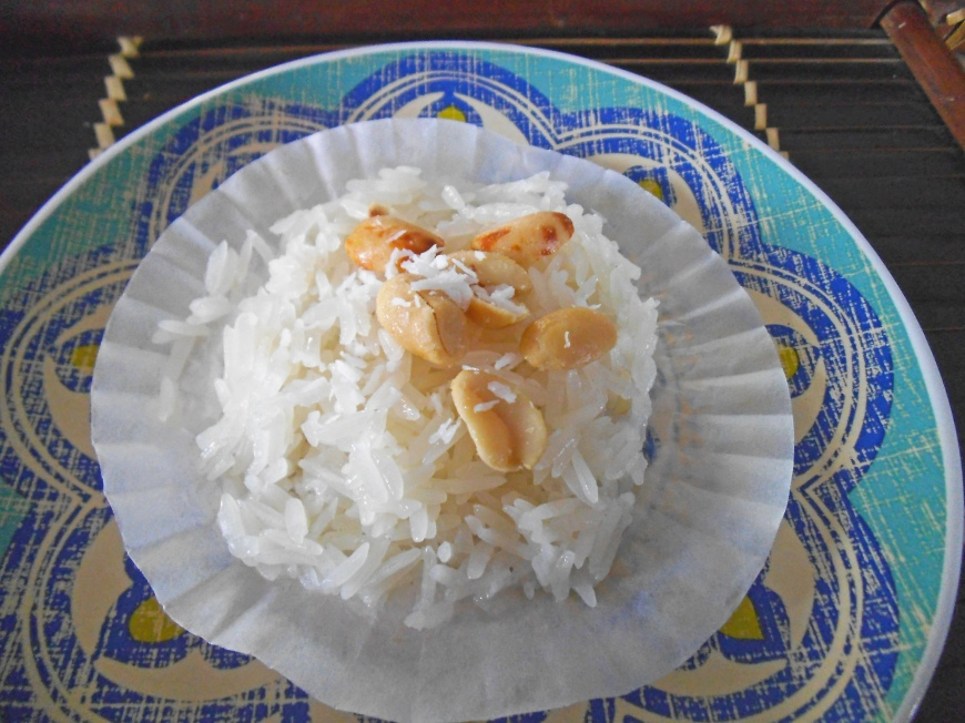 Sticky Rice Steamed in a Cupcake Liner - topped with peanuts